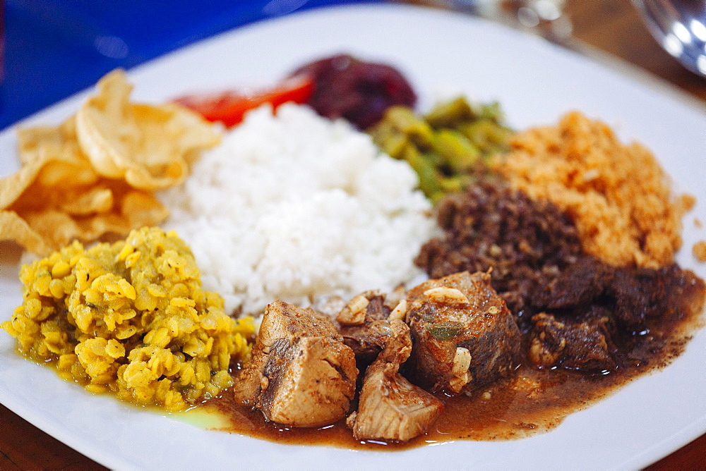 Traditional Sri Lankan cuisine including pol sambol, rotti and fish curry, Sri Lanka, Asia