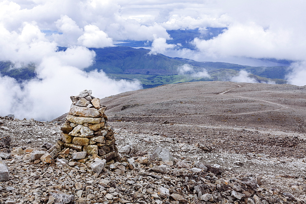 A pile of stones made by hikers and climbers along the Mountain Track (Tourist Route), Ben Nevis, Highlands, Scotland, United Kingdom, Europe - 10-393