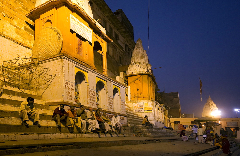 People sitting on steps at night. Varanasi, India - 1005-126