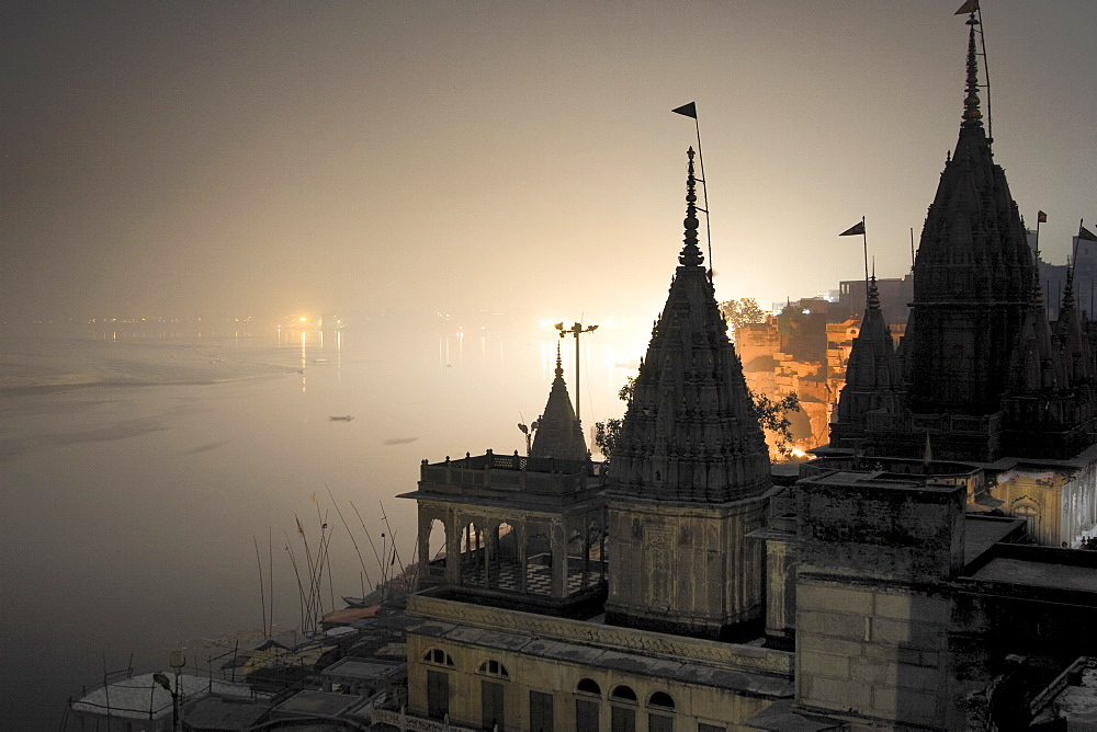 Temples at night on the banks of the river Ganges, Varanasi, India - 1005-141