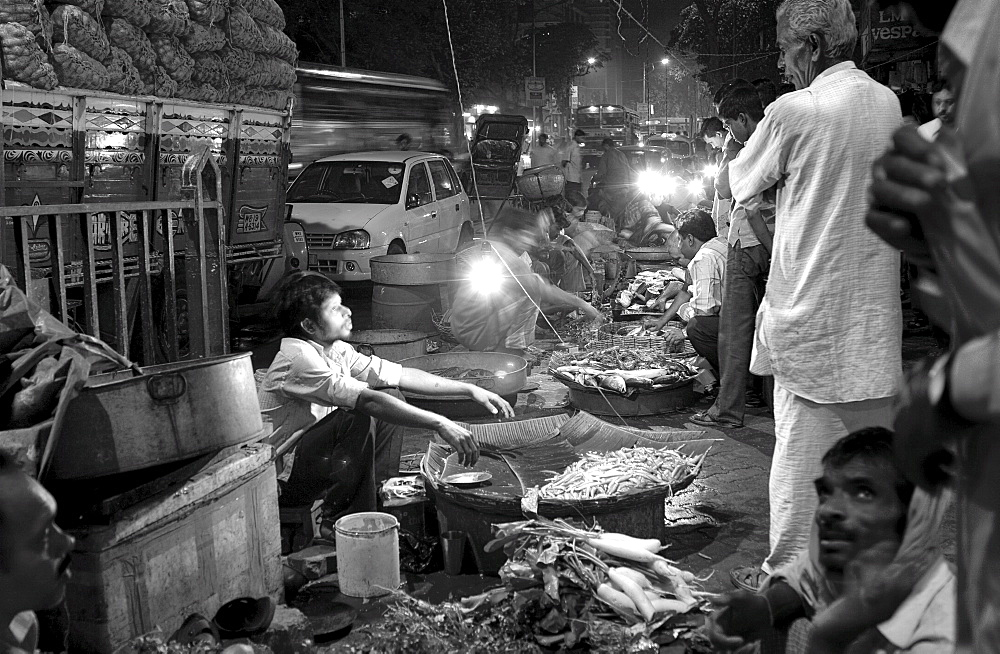 Locals barter at a late night fish market, Kolkata, India. - 1005-69