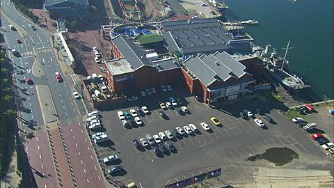 Aerial, Two Oceans Aquarium zoom out to Waterfront area and Table Mountain. South Africa