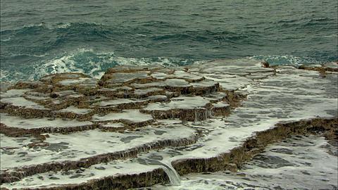 Coastline, blowhole, Cam looking to sea, sunlit terraces wall tide pool Tonga, South Pacific Ocean