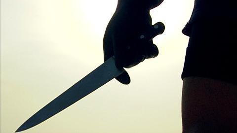 Man cleans knife for finning, Saudi Arabia, Gulf