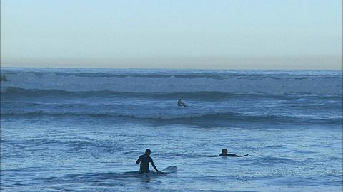 Surfer boys with body boards, Muizenberg Beach, Cape Town, South Africa