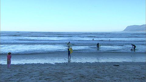 People on beach, surfers, Muizenberg Beach, Cape Town, South Africa