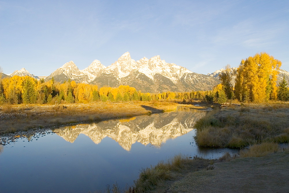 Grand Teton mountains reflected in Snake River at dawn, Wyoming, USA - 1024-59