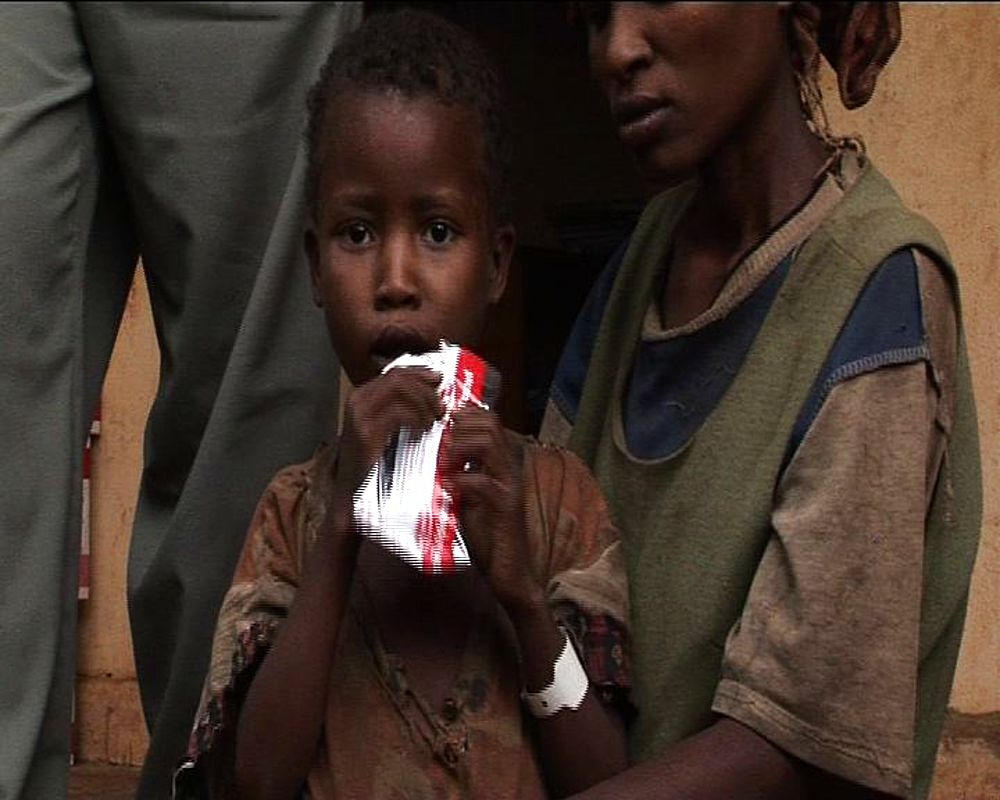 Famine Ethiopia. Children eat processed (plumpy nut) food. Ethiopia