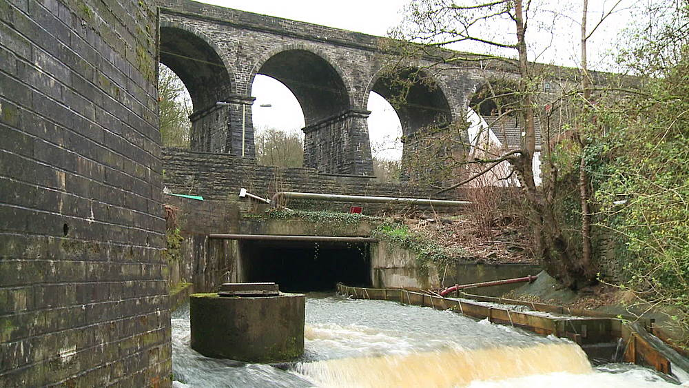 (wide shot) viaduct to river & fish pass, South Wales Valleys, Wales, United Kingdom