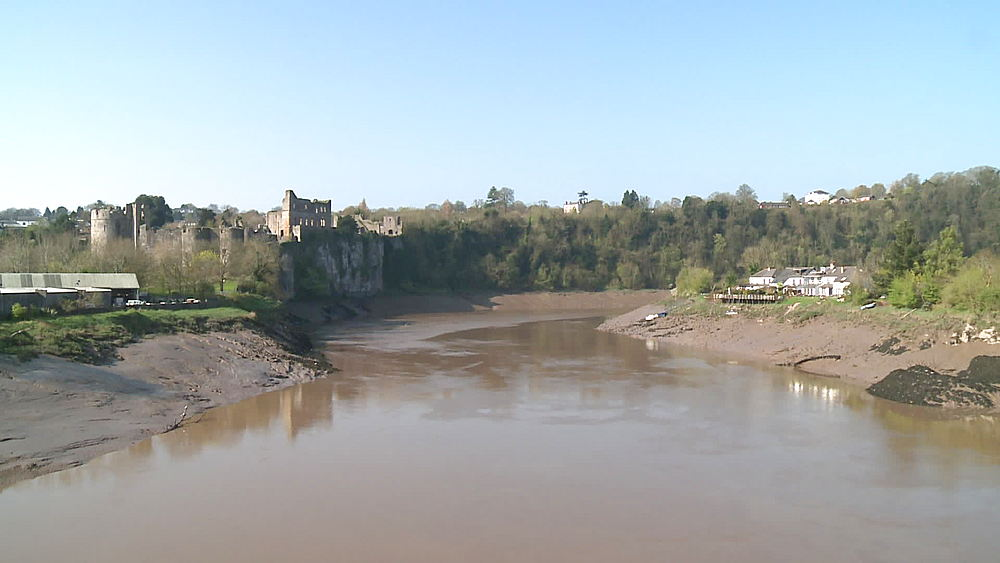 (wide shot) Wye River with castle &both banks low tide, Chepstow, Wales, United Kingdom, Europe