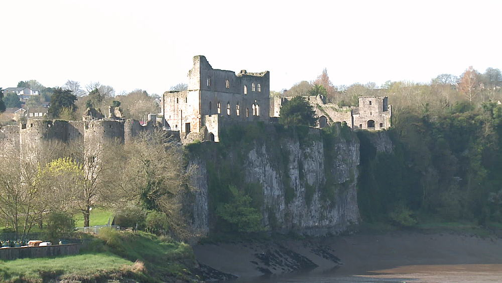 (medium wide shot) castle with river & cliffs, Chepstow, Wales, United Kingdom, Europe