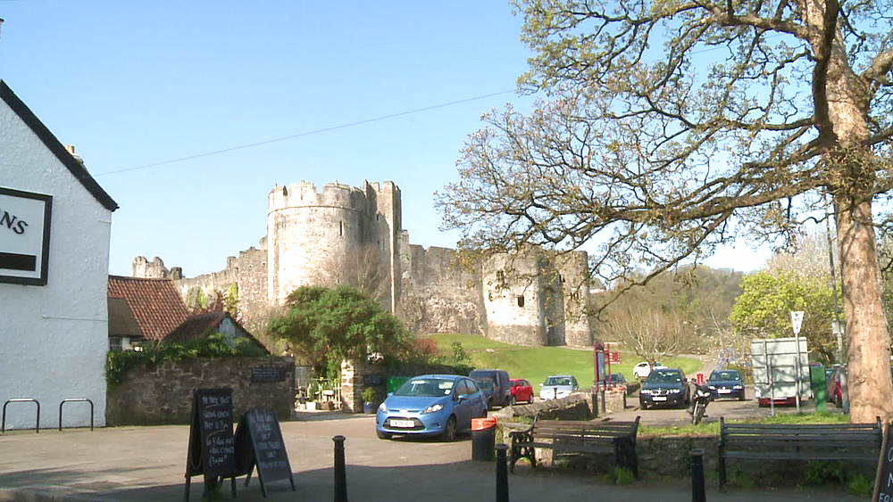 (wide shot) castle with car park foreground, Chepstow, Wales, United Kingdom, Europe
