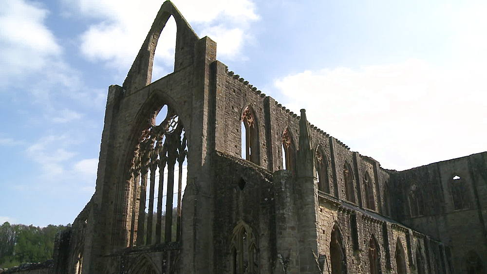 (medium wide shot) big arch window at end of abbey, Tintern, Wales, United Kingdom, Europe