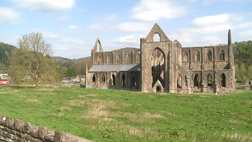 abbey (wide shot) pan to oiutbuildings, Tintern, Wales, United Kingdom, Europe
