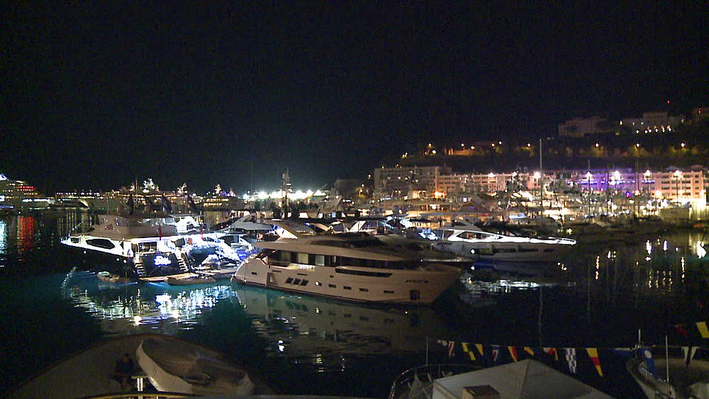 harbour wide shot at night yachts lit up