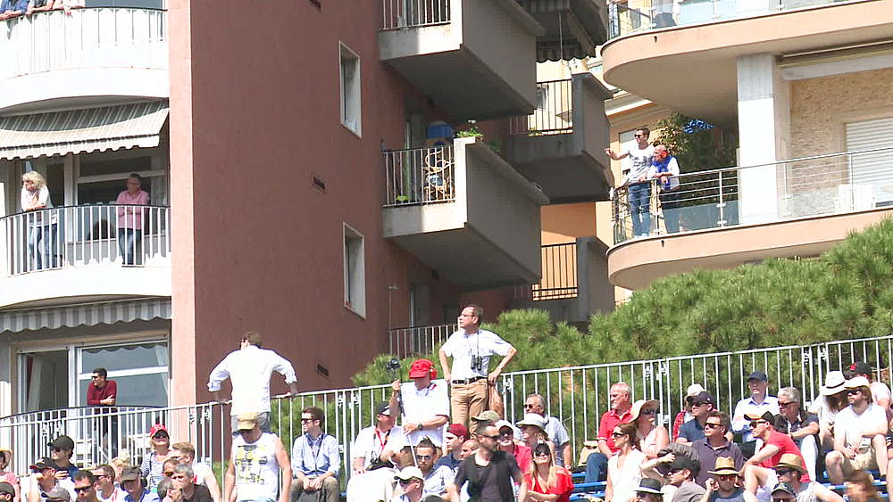 medium shot fans in top of stadia and flats behind - 1031-2153