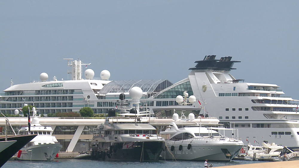 wide shot luxury cruise ships in harbour