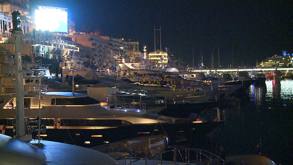 medium wide shot yachts bowide shot at night lit up