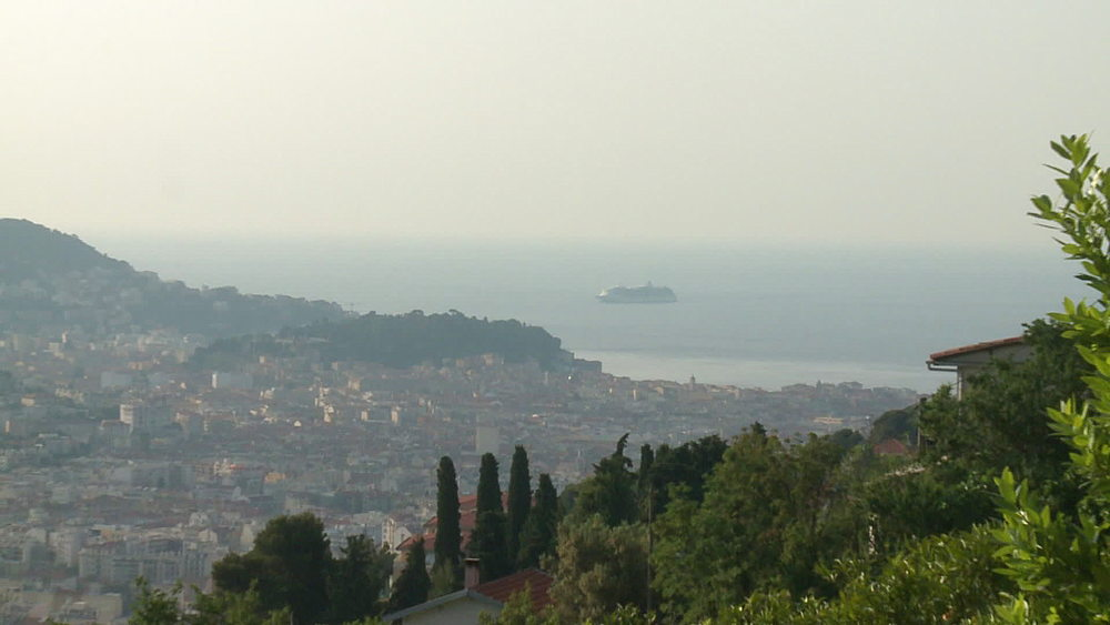 wide shot & very wide shot of town with cruise ship passing