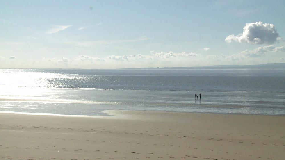 ws  & pan beach in sun distance figures - 1031-2218