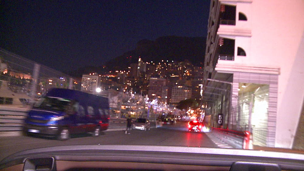 driving pov into Monaco harboir at night