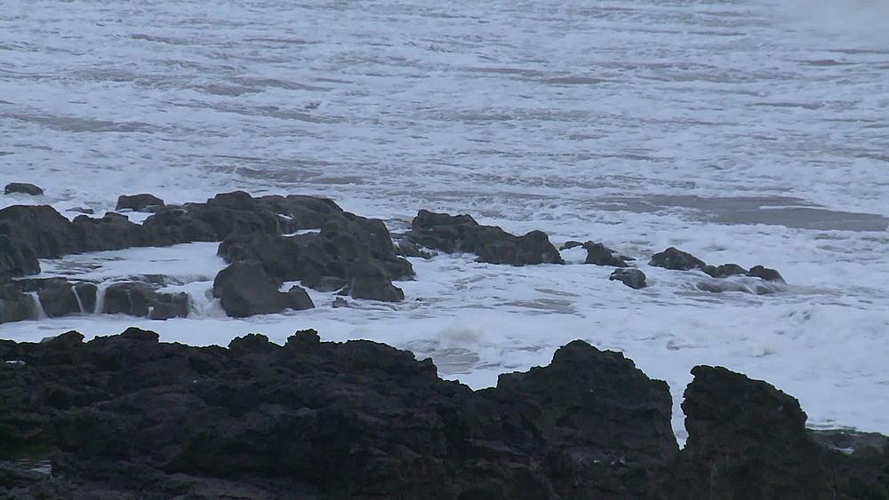 Breaking waves on rocks, Porthcawl, Wales, United Kingdom (medium-close-up & medium-shot) - 1031-2268
