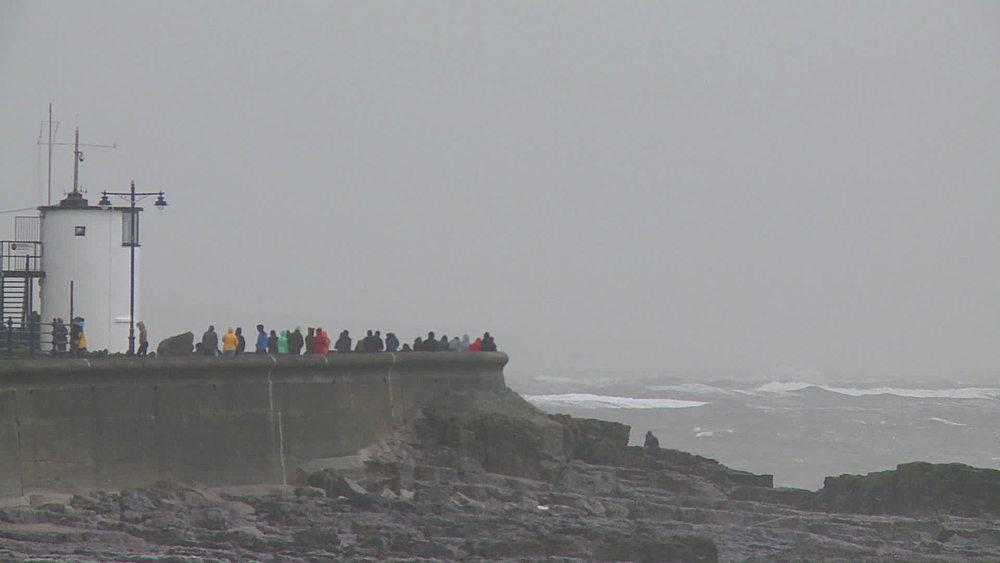 People on sea wall & stormy sea, Porthcawl, Wales, United Kingdom (medium-shot) - 1031-2269
