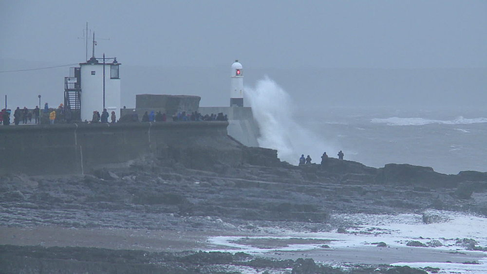 People and lighthouse with big wave breaking, Porthcawl, Wales, United Kingdom - 1031-2272