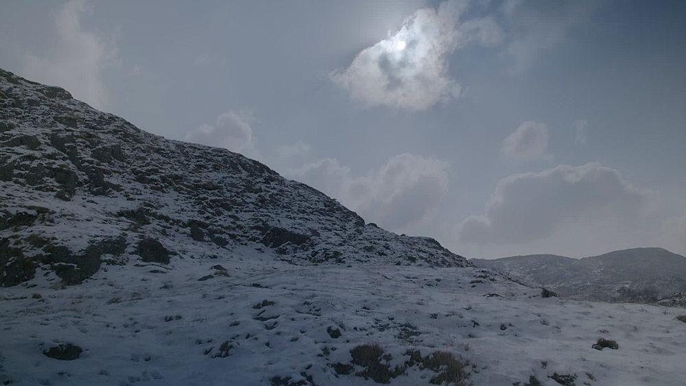 snowy hillside sun through clouds - 1031-2350