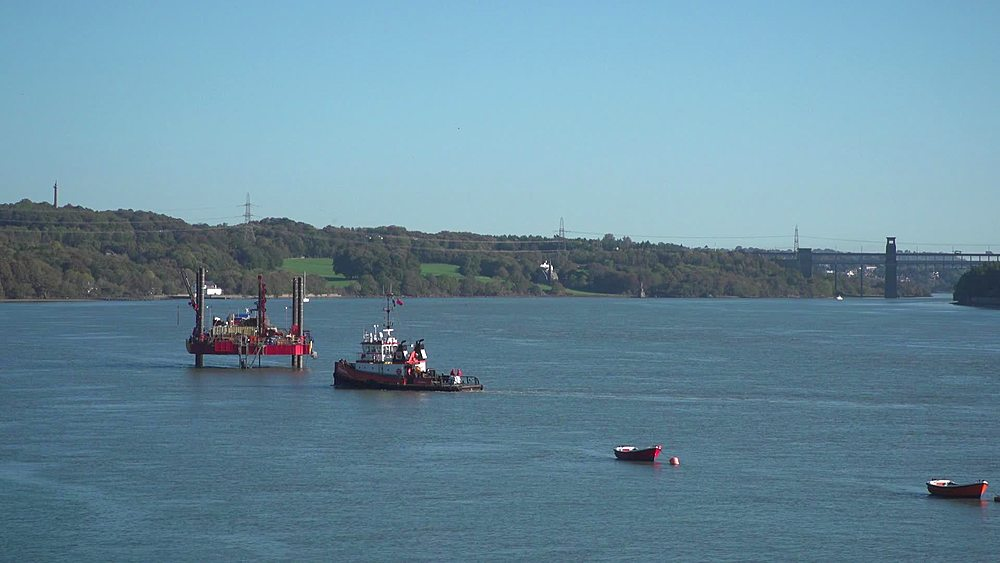tug boat approaches drilling rig (wide and mid shots) - 1031-2379