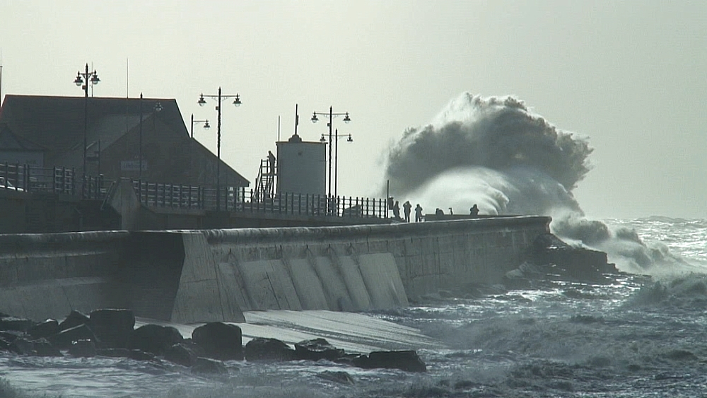 Sea defences and storm waves. Seaside town. UK
