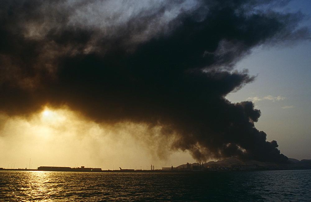 Oil refindery on fire.  Island in Arabian Gulf - 1036-252