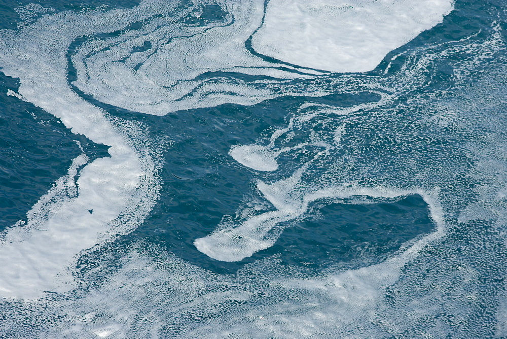 Tidal currents showing in natural patterns (of dead plankton).  Walker Bay, Western Cape, South Africa.