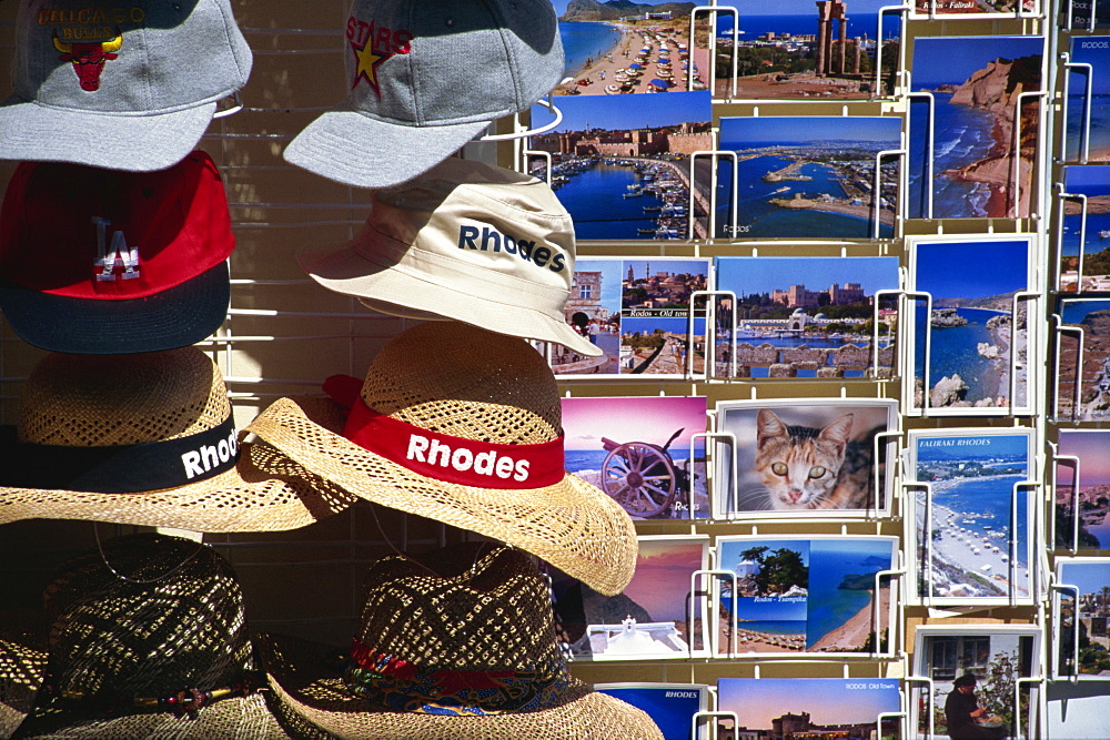 Postcards and hats for sale, Rhodes, Dodecanese, Greek Islands, Greece, Europe - 110-10421