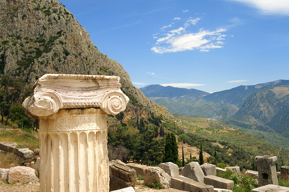 Close-up of capital on a column with hills in the background, at Delphi, UNESCO World Heritage Site, Greece, Europe