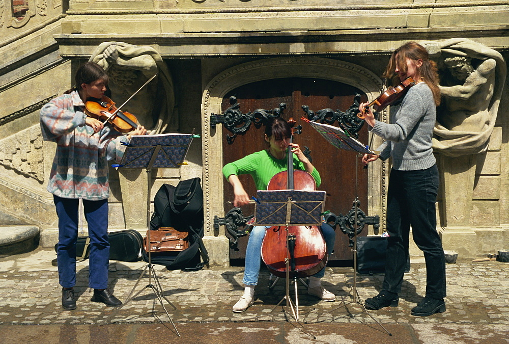Musicians busking outside Town Hall, Gdansk, Pomerania, Poland, Europe