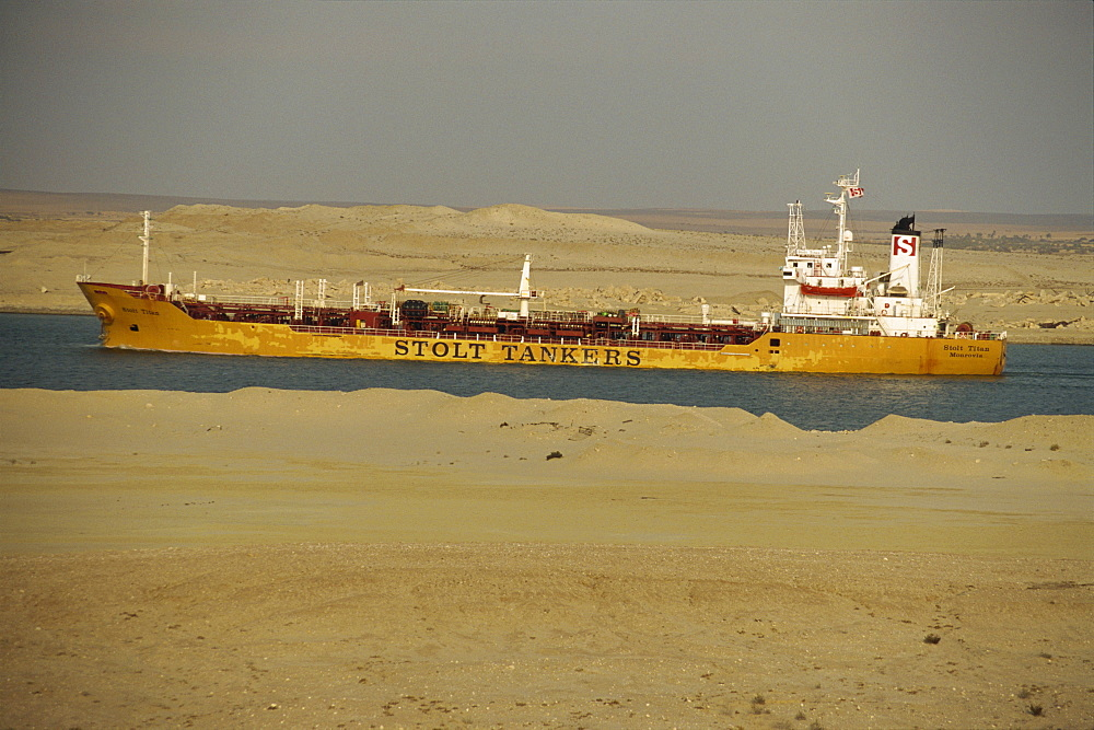 Tanker passing through Suez Canal with desert on either side, Egypt, North Africa, Africa