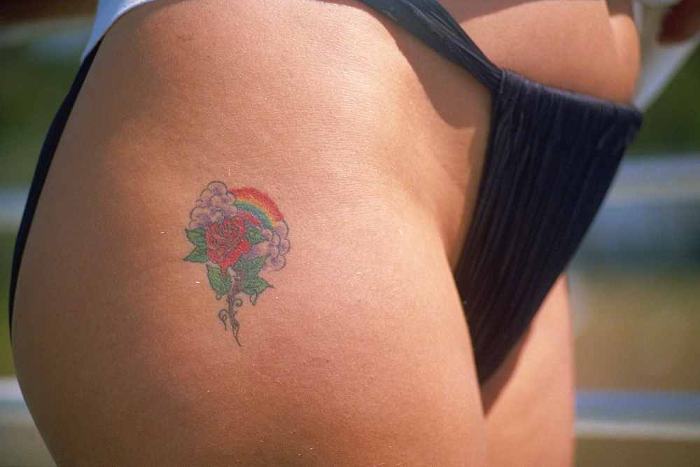 Rose and rainbow tattoo on thigh - 110-4259