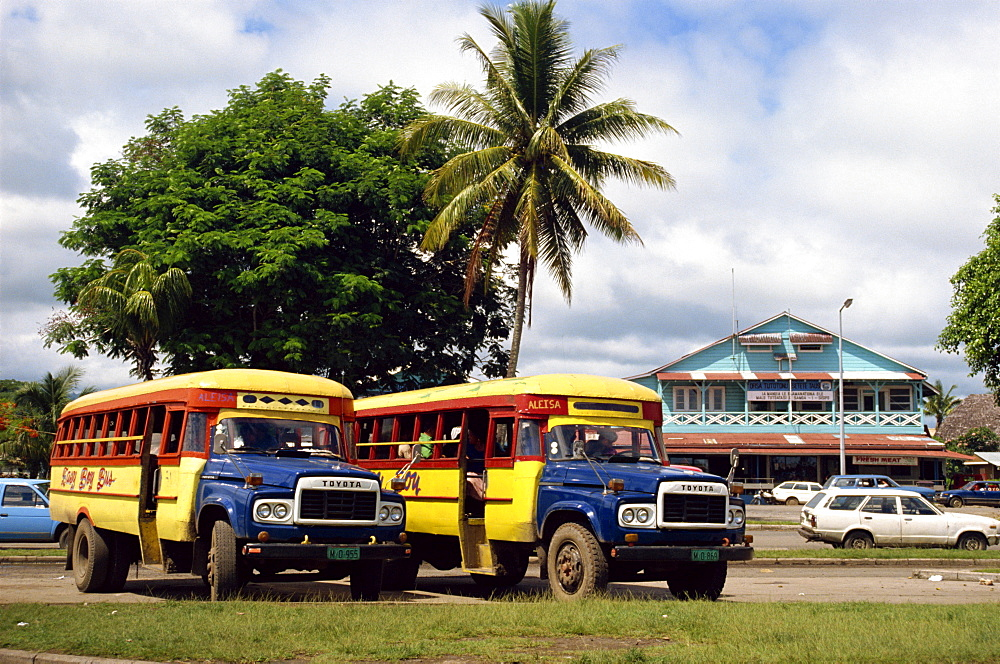 Local buses on a street in Apia, Upolu Island, Western Samoa, Pacific