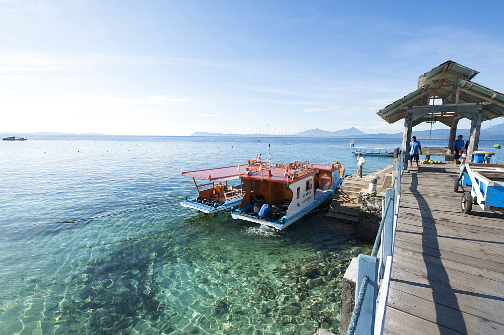 Dive boats at Gangga Island jetty, Sulawesi, Indonesia, Southeast Asia, Asia