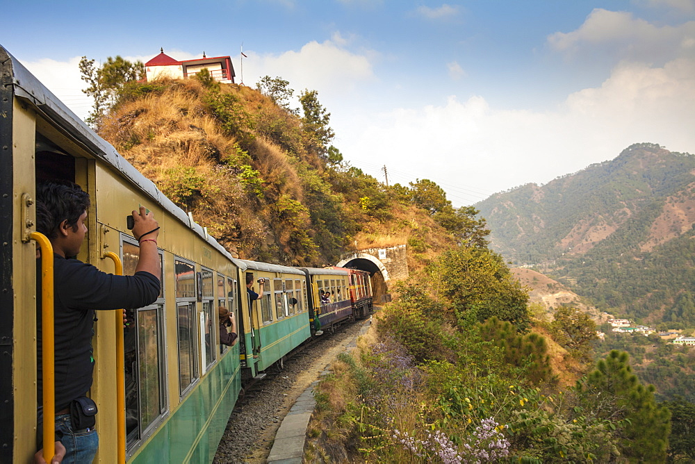 The Himalayan Queen toy train approaching a tunnel, on the Kalka to Shimla Railway, UNESCO World Heritage Site, Northwest India, Asia