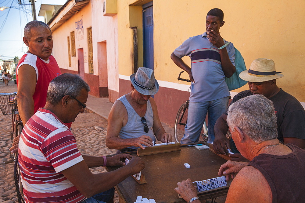 People playing Dominoes in street, Trinidad, Cuba, West Indies, Caribbean, Central America