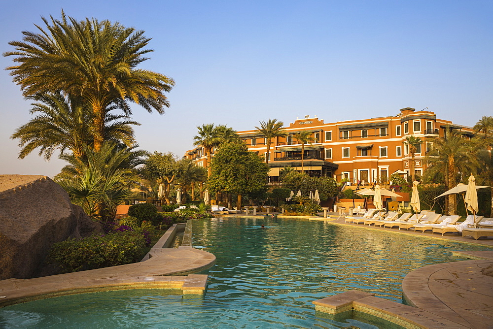 Egypt, Upper Egypt, Aswan, Swimming pool at Sofitel Legend Old Cataract hotel situated on the banks of the river Nile - 1104-767