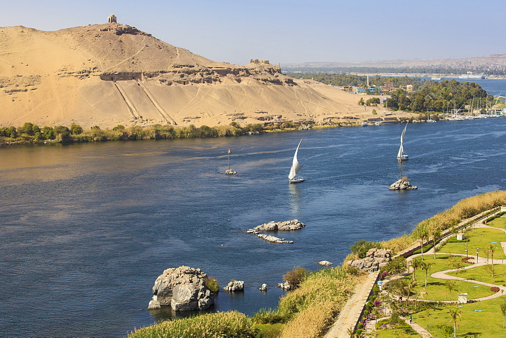Egypt, Upper Egypt, Aswan, Elephantine Island, View of river Nile, Tombs of the Nobles on the West Bank and the gardens of the Movenpick Resort