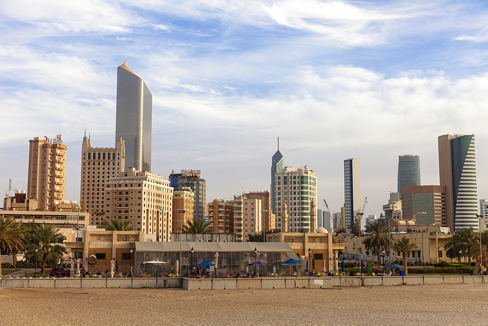 Looking towards city center buildings from a beach on Arabian Gulf Street, Sharq, Kuwait City, Kuwait, Middle East