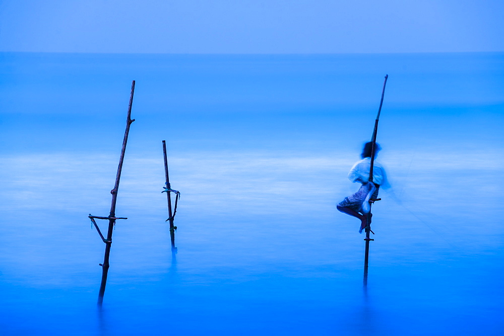Stilt fisherman fishing at Midigama near Weligama, South Coast, Sri Lanka, Indian Ocean, Asia