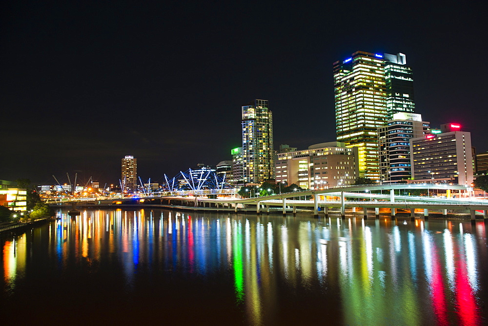 Colourful reflection of city skyline in Brisbane River at night, Brisbane, Queensland, Australia, Pacific