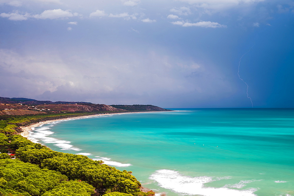 Thunder and lightning storm over Capo Bianco Beach and the Mediterranean Sea in the Province of Agrigento, Sicily, Italy, Europe