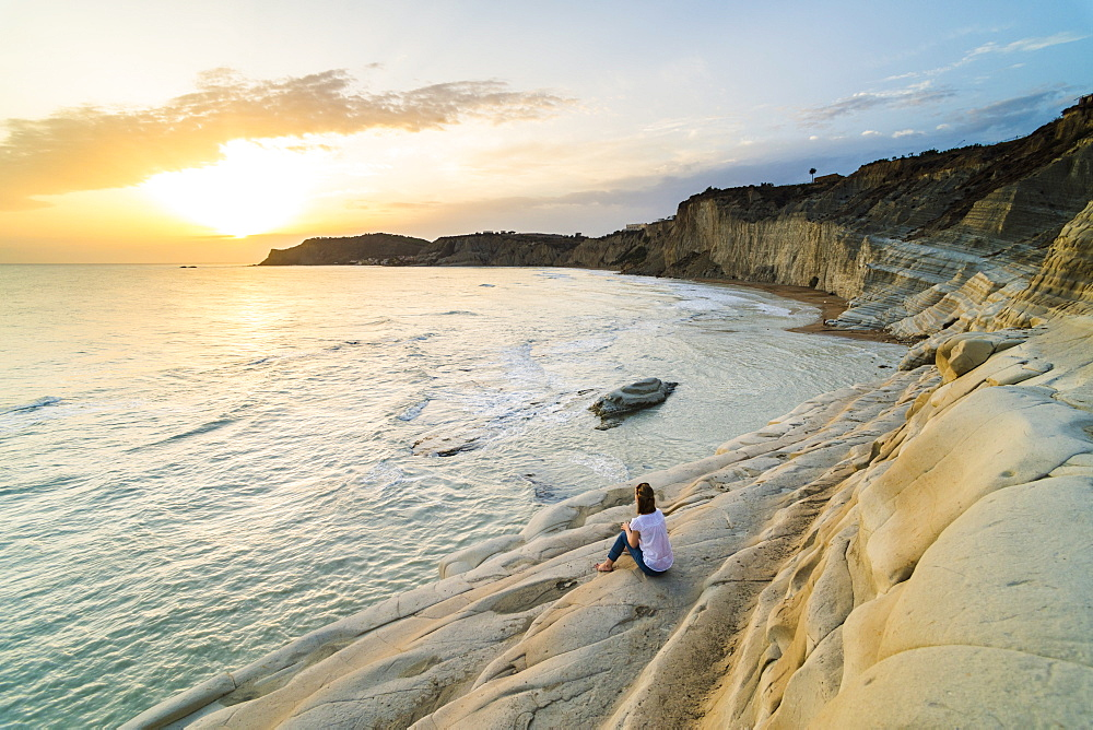 Tourist watching the sunset on Scala dei Turchi, Realmonte, Agrigento, Sicily, Italy, Mediterranean