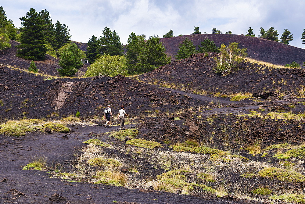 Tourists visiting an old lava flow from an eruption on Mount Etna, UNESCO World Heritage Site, Sicily, Italy, Europe